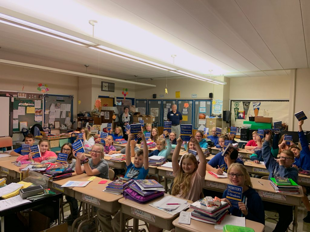 Fifth grade students at Reynolds Elementary hold up their new thesauri.