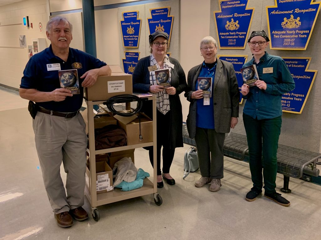 Transfer Kiwanis show off the new dictionaries they are helping to distribute.